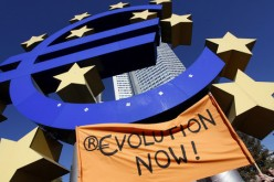 Страны еврозоны не могут выбраться из долговой ямы, а немецкие кредиторы уменьшают объемы их кредитования