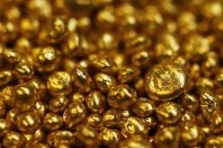 Цена на золото упала вслед за спросом на безопасные активы