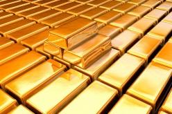 Золото возобновило рост