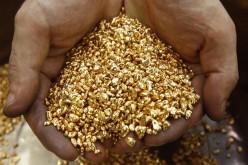 Золото отыгрывает потери в ходе американской сессии