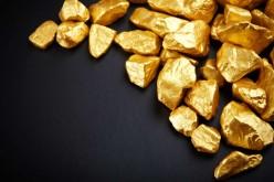 Золото находится под давлением слухов об увеличении учетной ставки ФРС
