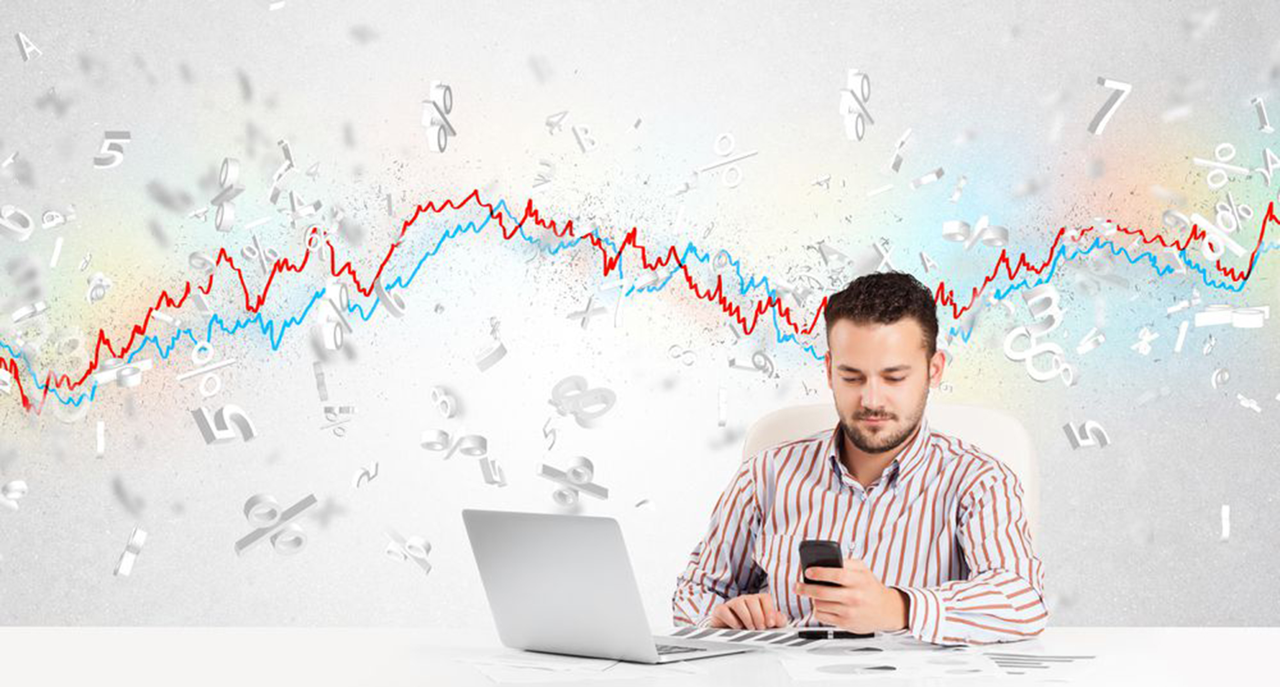 Business man sitting at table with stock market graph 3d letters