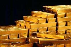 Золото опустилось до полумесячных минимумов